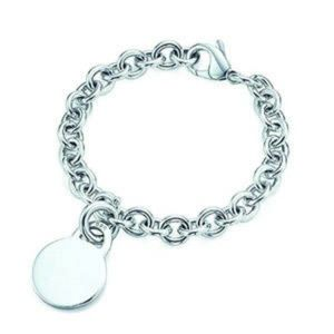 Return to Tiffany & Co Round Tag Charm Bracelet